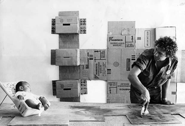 Rauschenberg in front of one of his Cardboard series, 1971. Photograph by Hans Namuth