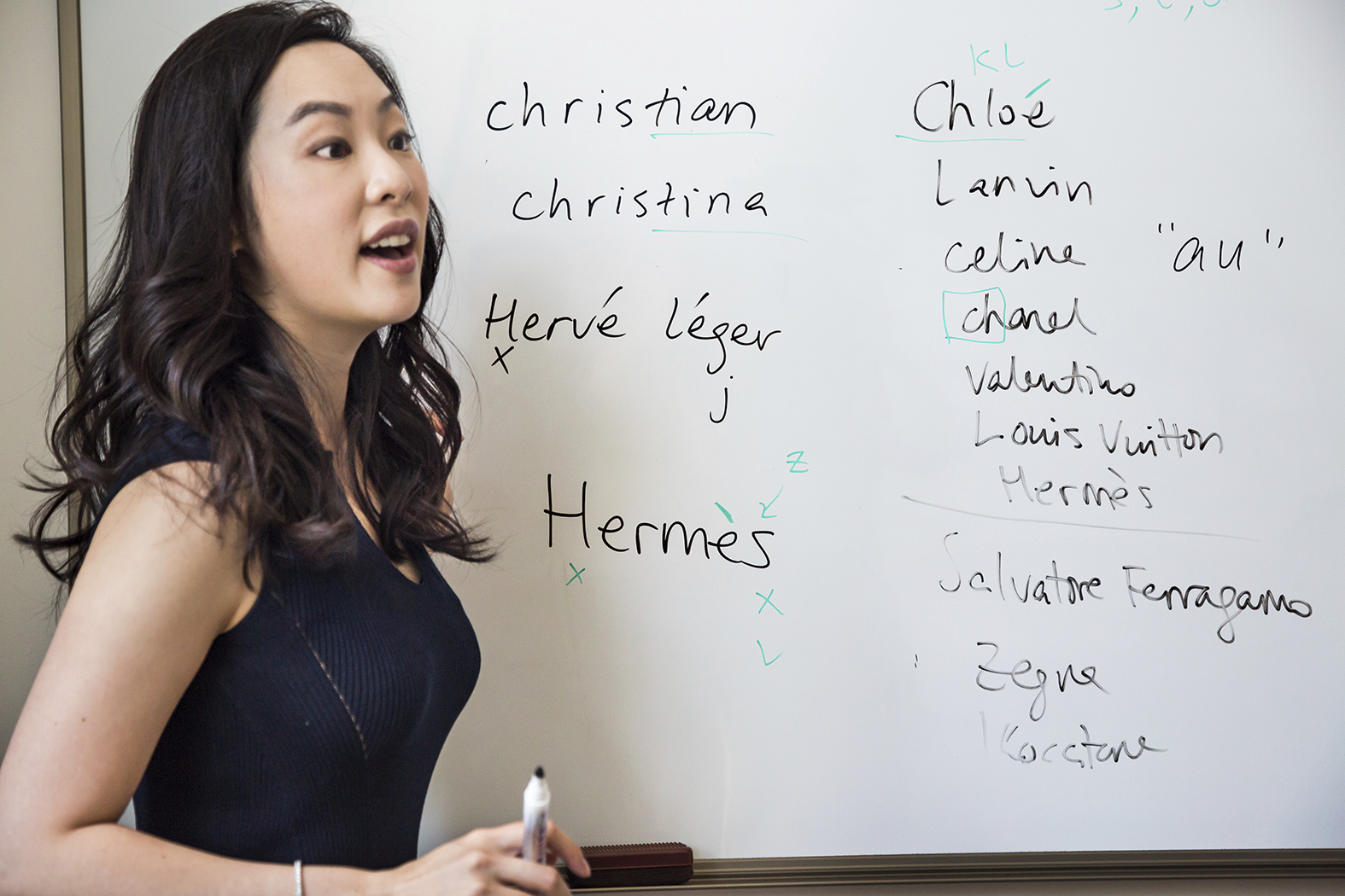 Sara Jane Ho, 28, teaches etiquette skills for the wealthy, such as the proper pronunciation of foreign luxury brand names, Beijing, 2014; a still from Generation Wealth