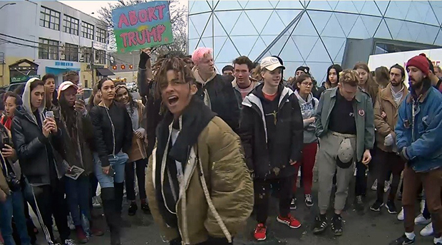 Jaden Smith (centre) and Shia LaBeouf (right) at He Will Not Divide Us, 2016 by LaBeouf, Rönkkö & Turner