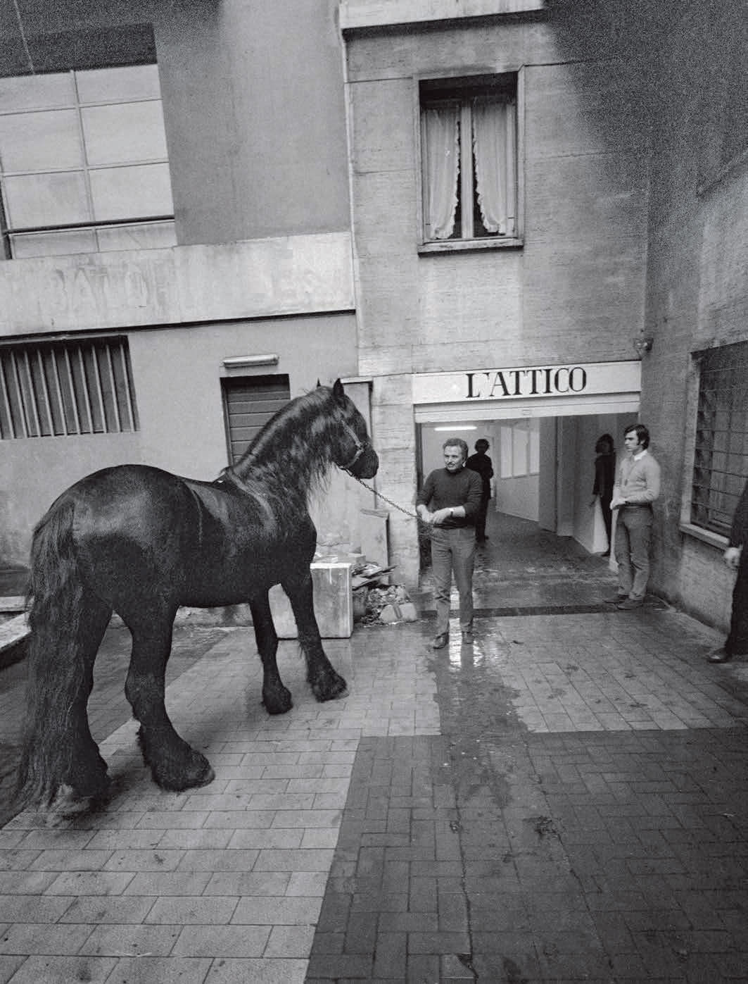 Gallery assistants at work on Untitled (Cavalli), Galleria L'Attico, Roma, 1969