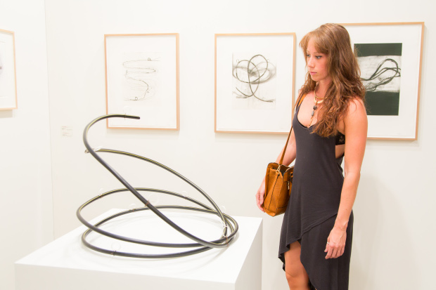 A visitor takes in an Al Taylor sculpture at the Borch Jensen, Art Basel Miami Beach 2013