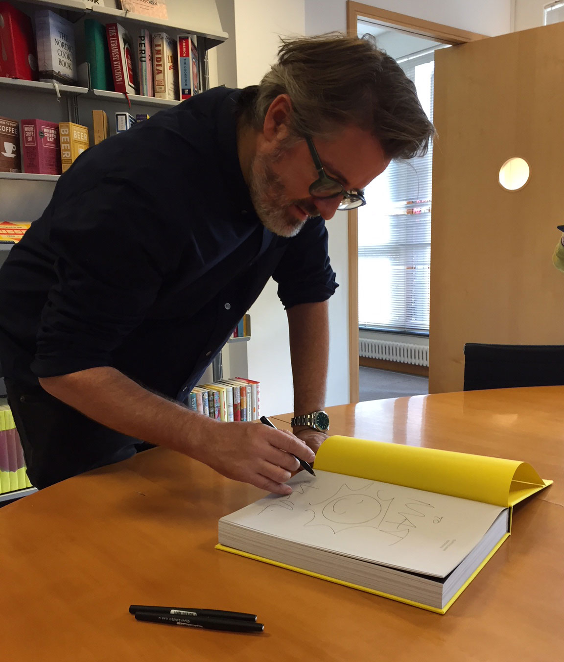Olafur Eliasson signing copies of Experience at Phaidon