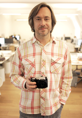 Marc Newson holding the Pentax K-01