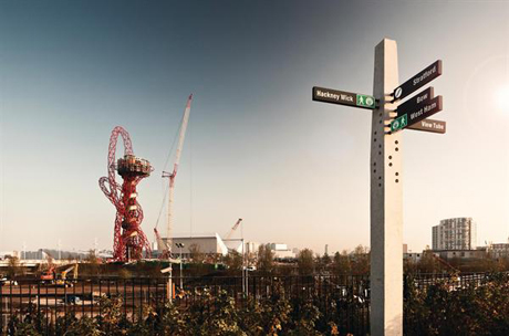 Photograph of the <em>Orbit Tower</em> rising over London's East End (Photography by Dylan Collard)