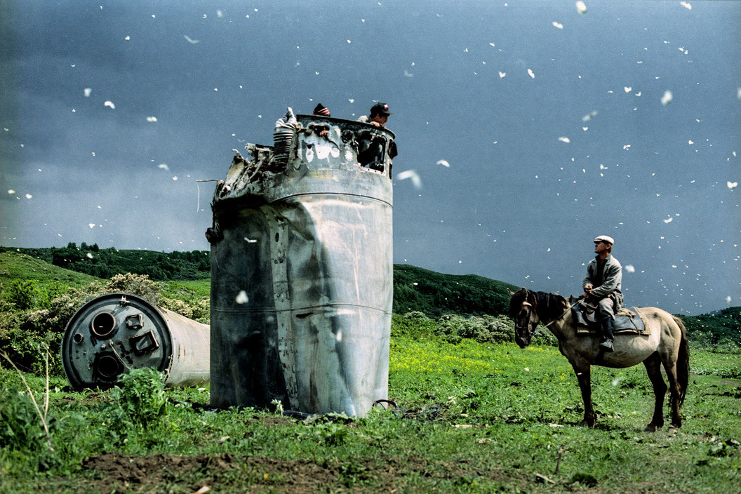 Altai Territory, Russia, 2000. Villagers collecting scrap metal from a crashed space rocket, surrounded by thousands of butterflies by Jonas Beniksen