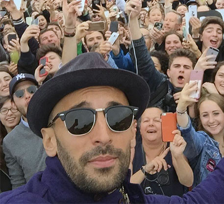JR outside the Louvre, Paris, with fans