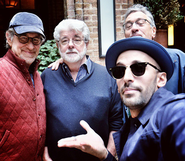 JR (sunglasses, near right) talking art and ideas with Steven Spielberg, Georges Lucas and Robert De Niro. (The artist says De Niro photobombed the pic!)