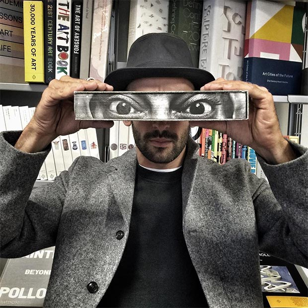 JR with his new book, JR: Can Art Change The World, Phaidon's London offices, September 2015