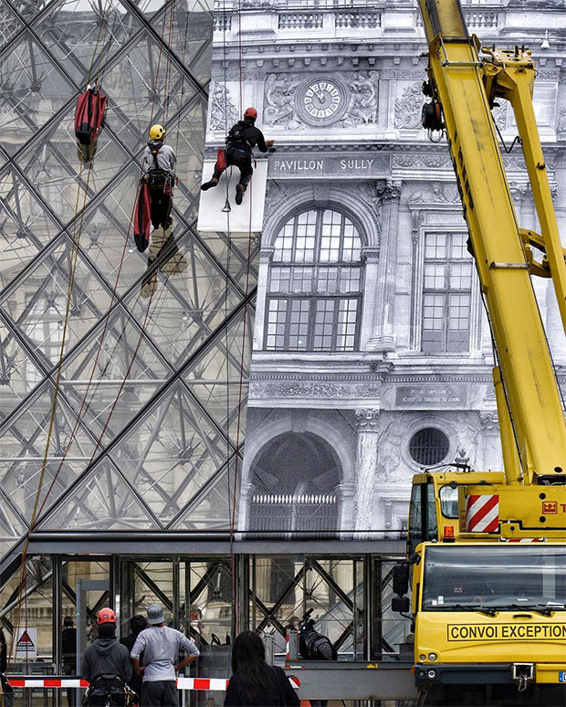 R's work being pasted up at the Louvre. Image courtesy of JR's Instagram