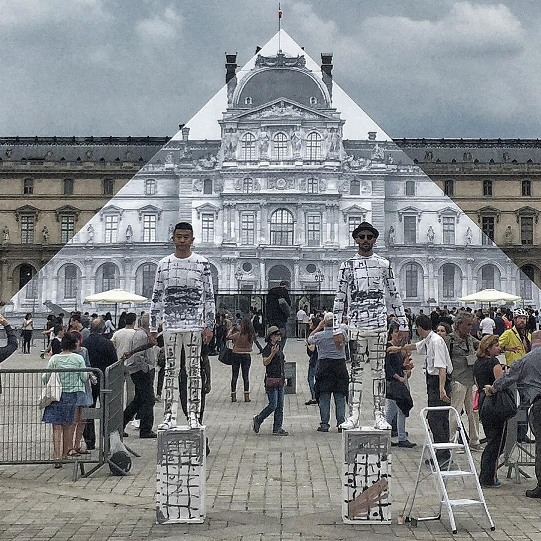 JR and Liu Bolin beside the Louvre Pyramid