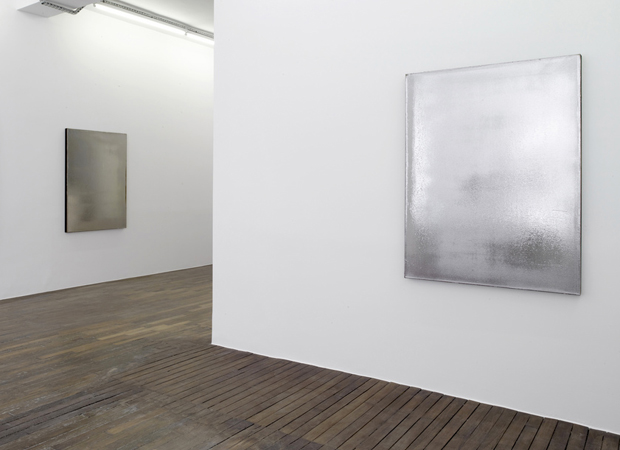 Installation image of Jacob Kassay's 2010 silver paintings, acrylic and silver deposit on canvas. Image courtesy of the ICA