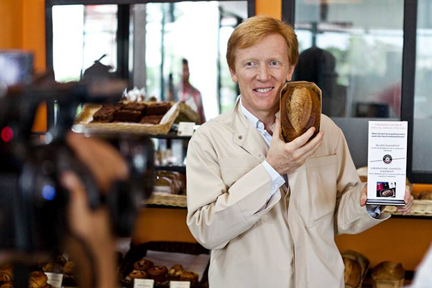 Éric Kayser with his kampot pepper bread at the launch of his Phnom Penh branch