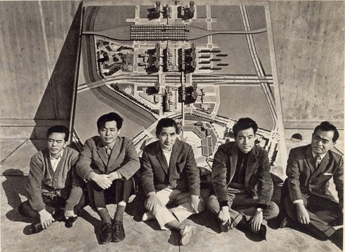 Kenzo Tange (centre) and his team, in front of their plan for Skopje