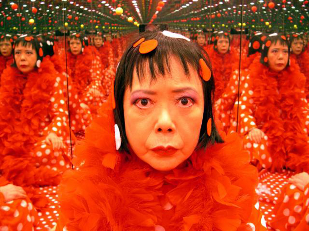Yayoi Kusama in one of her mirror rooms, 2004