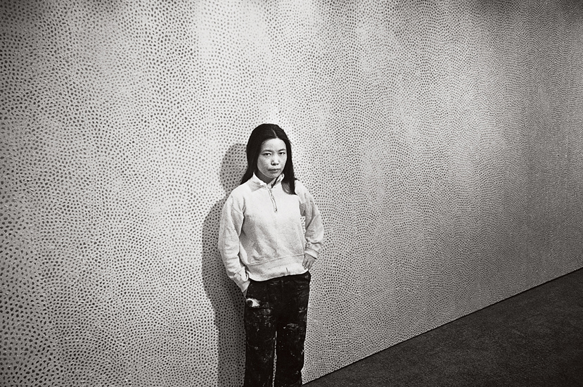 Yayoi Kusama with an Infinity Net painting at the Stephen Radich gallery, New York, 1961