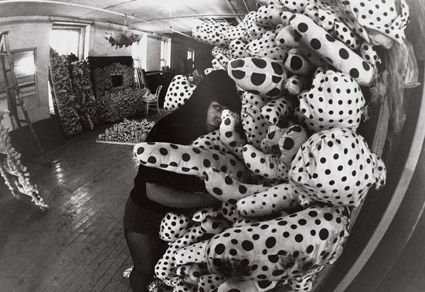Yayoi Kusama with accumulation pieces at her studio in New York (c. 1963 - 64)