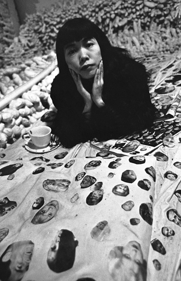 Yayoi Kusama, with her work, Face Obsession, 1964