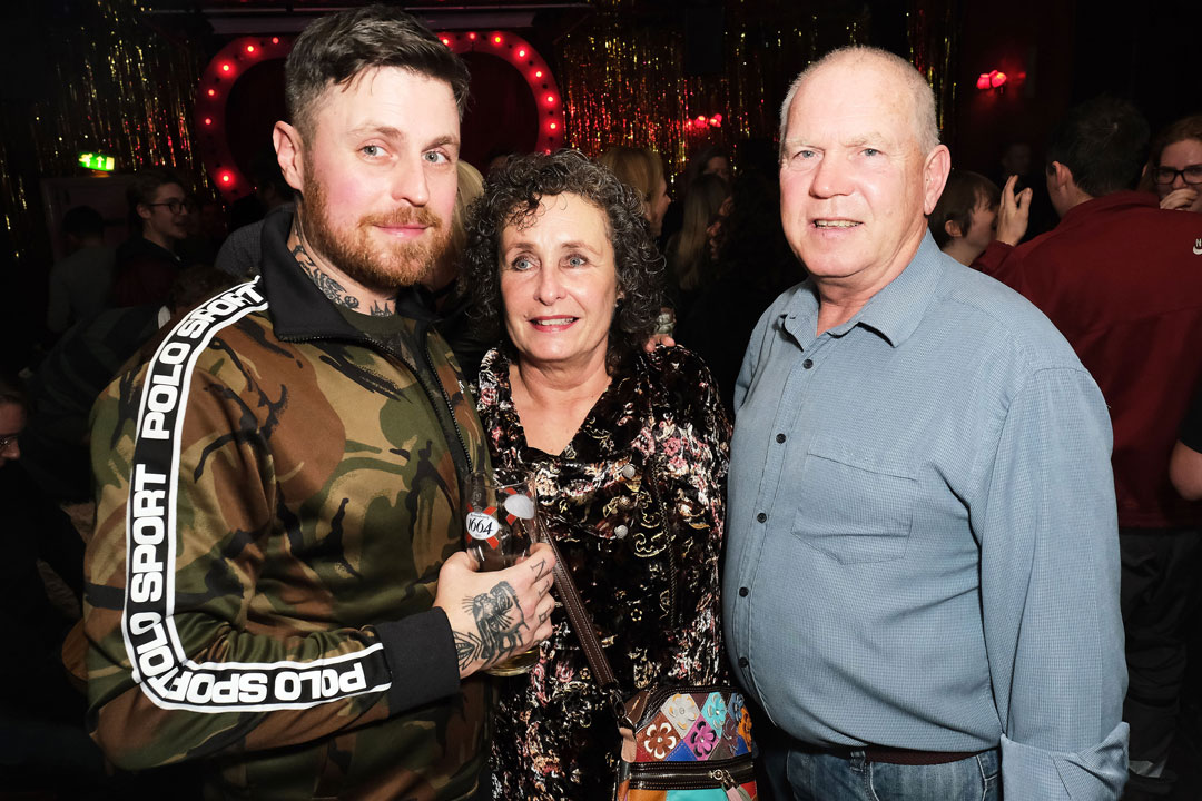 Lee Tiernan with his parents Moira and Patrick Tiernan at the Black Axe Mangal launch party at the Bethnal Green Working Men's Club, London