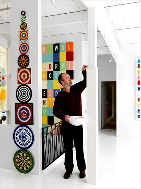 Coupland builds Lego around one of his second home's pillars. Photo by Martin Tessler