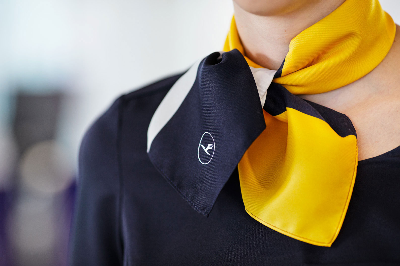 Aicher's yellow will be retained in some instances, such as in the staff uniforms. Image courtesy of Lufthansa