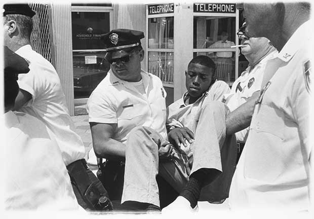 The arrest of Eddie Brown, a former gang leader, in Albany, Georgia 1962. The first arrest Lyon witnessed in the south - Danny Lyon from The Seventh Dog