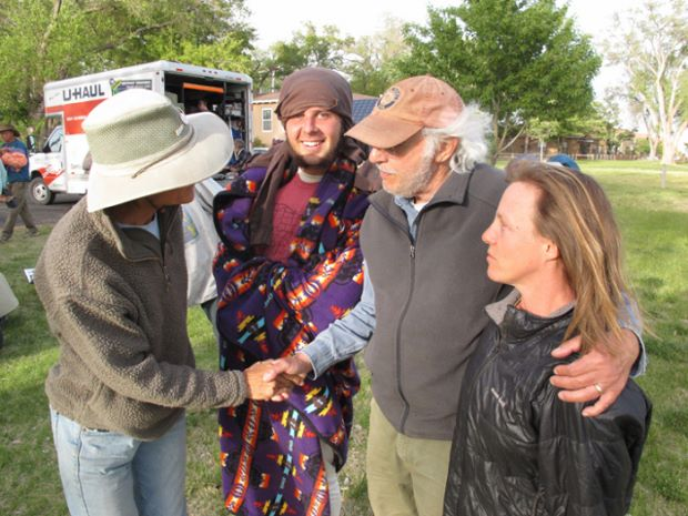 Danny Lyon (brown cap, second from right) greets Climate Marchers to Albuquerque, summer 2014