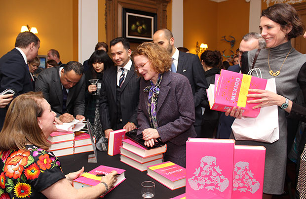 Margarita signs books for the ambassador's guests