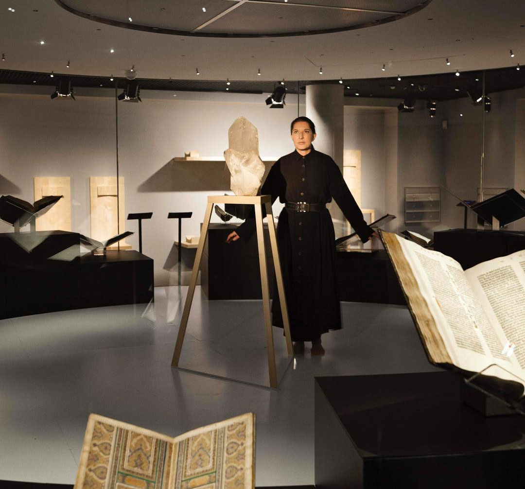 Marina Abramović in the library, with the ancient manuscripts