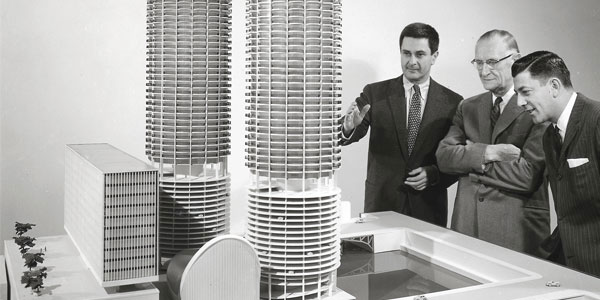 Goldberg showing the maquette for Marina City, Chicago
