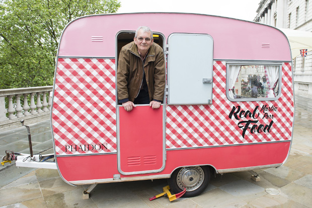 Martin Parr inside his Real Food van at Photo London, May 2016