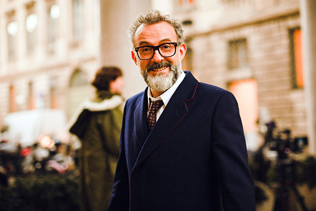 Massimo Bottura in a Gucci navy wool coat with red and blue piping. Image courtesy of British GQ, gq-magazine.co.uk