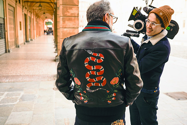 Massimo Bottura in a Gucci DIY leather bomber with snake appliqué. Image courtesy of British GQ, gq-magazine.co.uk