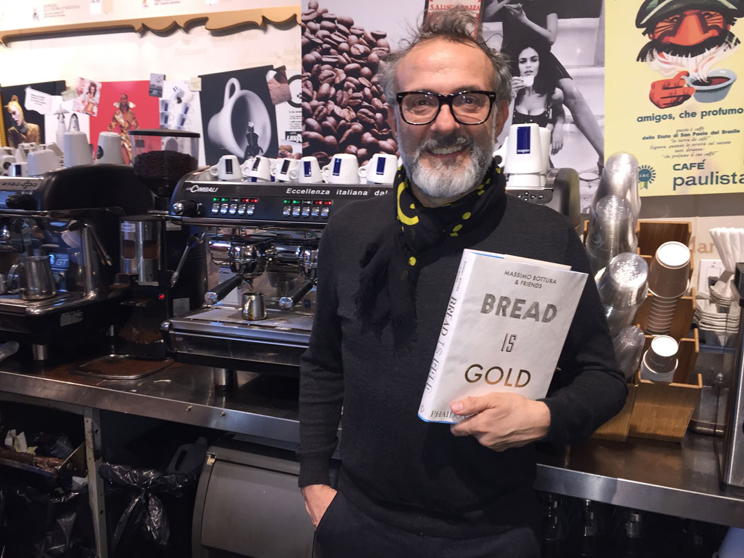 Massimo Bottura with a copy of his book in Eataly, New York City - photo Mat Smith
