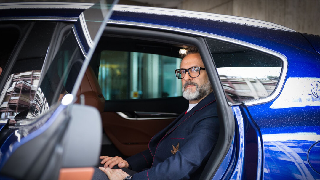 Massimo Bottura in a Maserati at the Geneva motor show. Image courtesy of Maserati