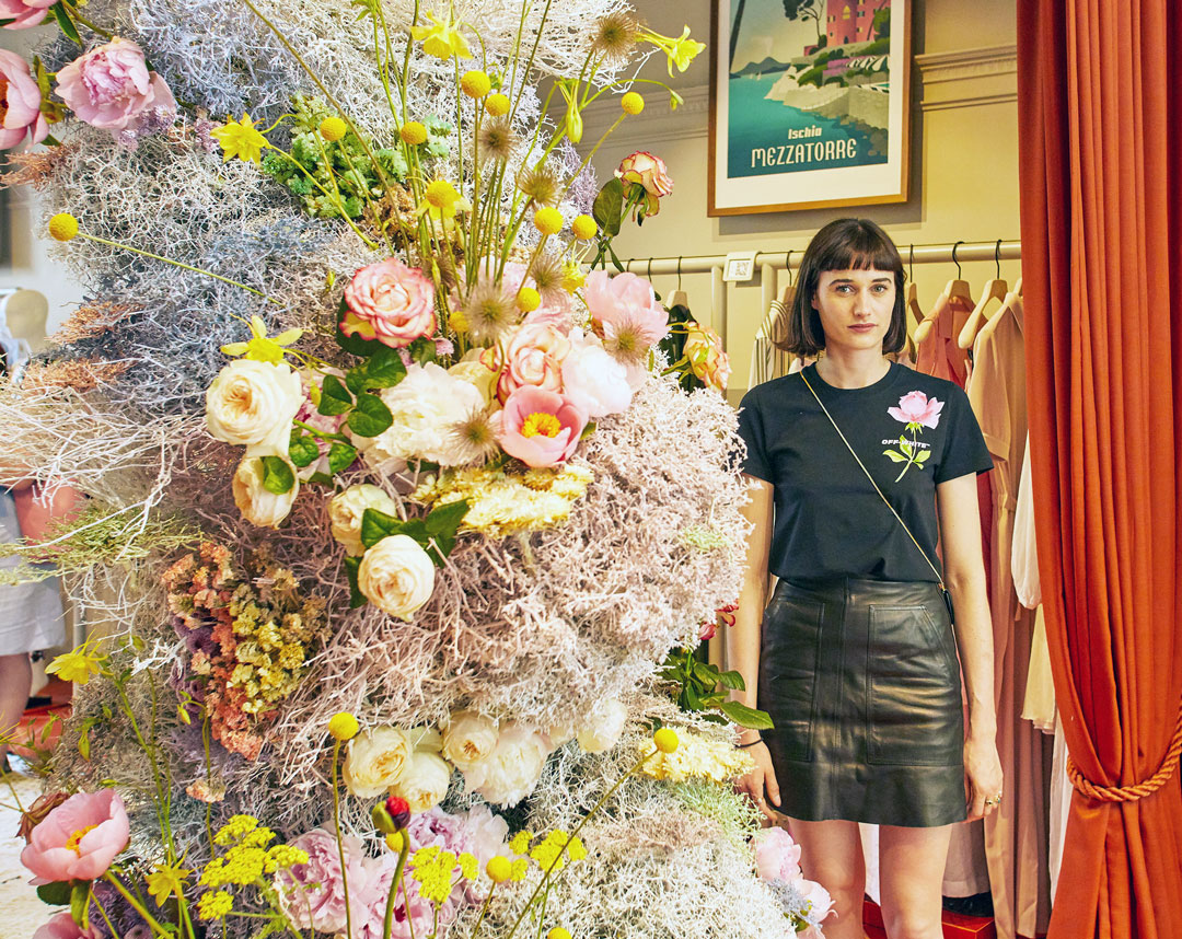 Emma Weaver of Palais Flowers with her display at 5 Carlos Place
