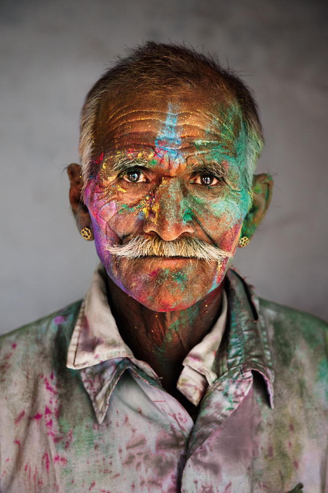 Rajasthan, 2009. Man covered in powder during Holi, the festival of colours. Photograph by Steve McCurry