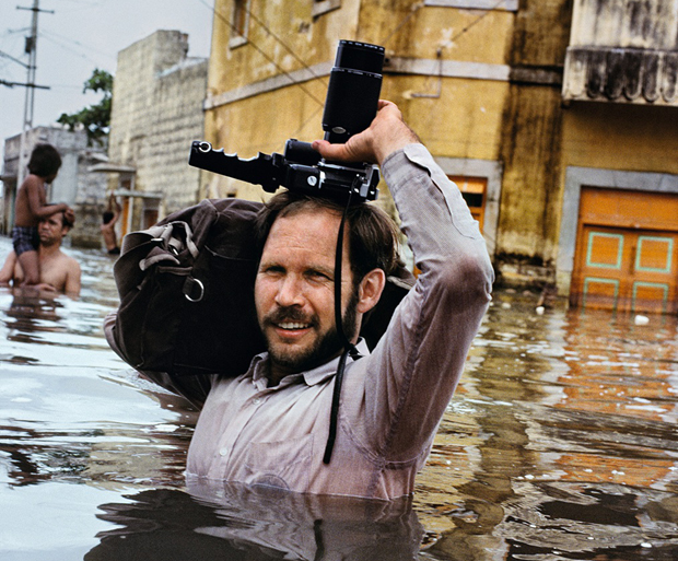 Steve McCurry in monsoon floods, Porbander, India, 1983. From Steve McCurry Untold: The Stories Behind the Photographs