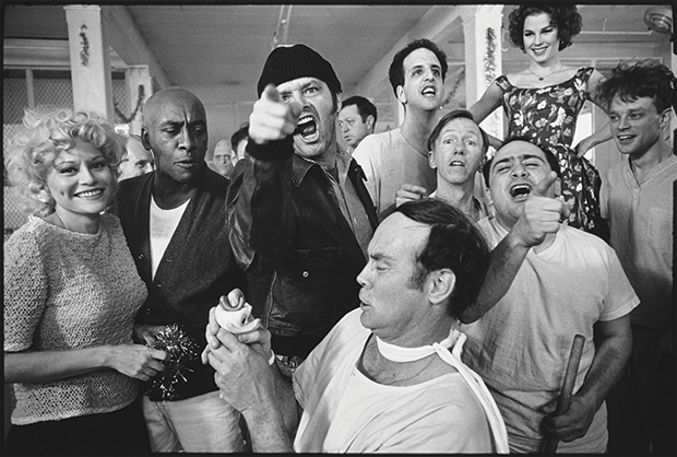 The cast of One FlewOver the Cuckoo's Nest posing for their picture on location at Oregon State Hospital, 1975, by Mary Ellen Mark