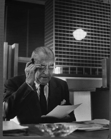 Mies with a model of new IBM building in background, ca. 1969–71