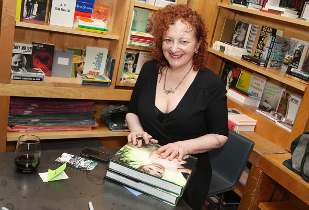 Nan Goldin signing copies of Eden and after at MarcBook - photo copyright Patrick Mcmullan.com