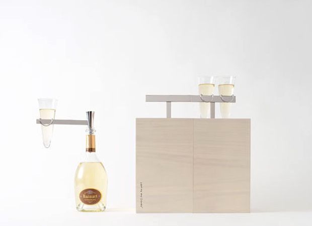 Champagne glasses perch like birds on telephone wires in this Japanese picnic box design, inspired by the urban landscape