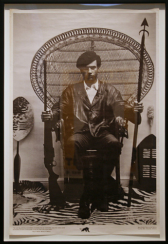 Huey Newton in a Peacock Chair. Photography attributed to Blair Stapp, composition by Eldridge Cleaver