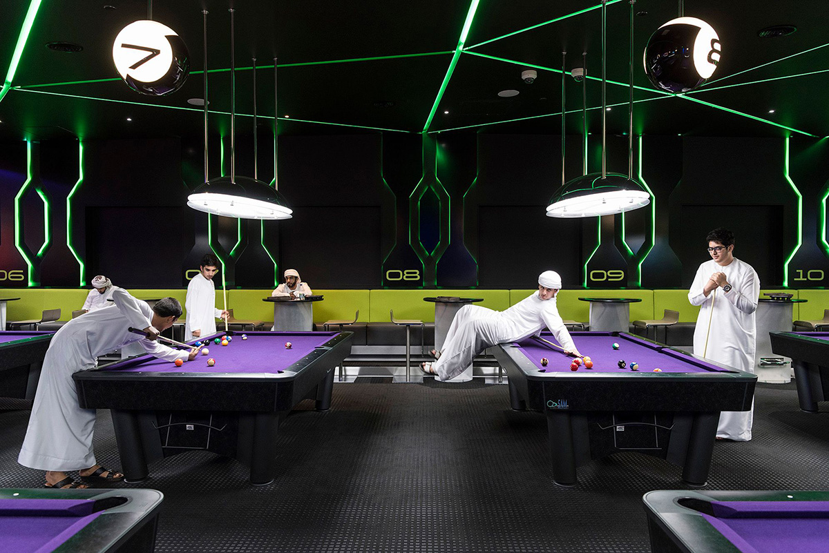 Hub Zero, Dubai, January 2017. Emirati boys playing a game of pool at Hub Zero, an immersive entertainment hub located at City Walk shopping mall. © Nick Hannes. Documentary Series Winner, Magnum and LensCulture Photography Awards 2017