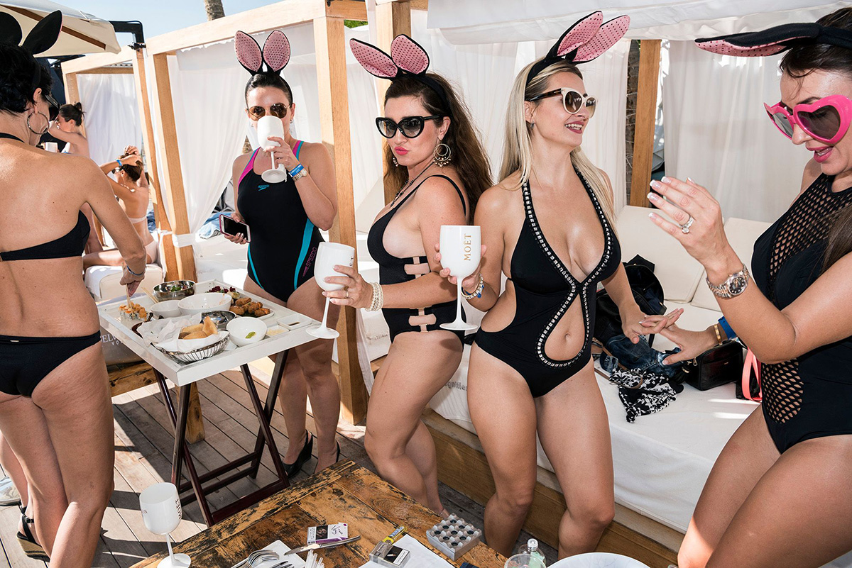 Beach party, Dubai, January 2016. Russian women celebrating Friday brunch at a beachclub in Dubai. © Nick Hannes. Documentary Series Winner, Magnum and LensCulture Photography Awards 2017