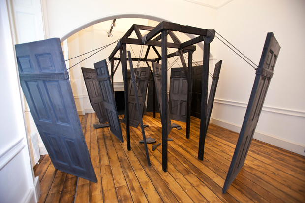 Nika Neelova, Partings (2012), concrete casts from a Somerset House door, burnt timber, rope, 4m x 3m approx