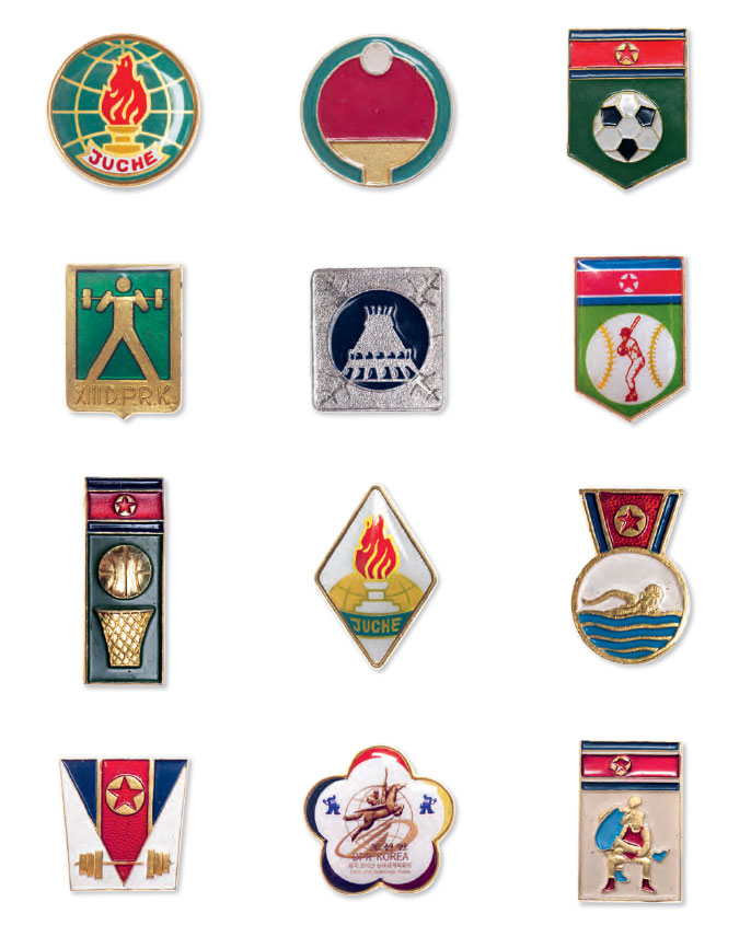 A selection of sporting badges from North Korea. The 'Juche' badges are in the middle column third row down from the top, and in the top row, far left