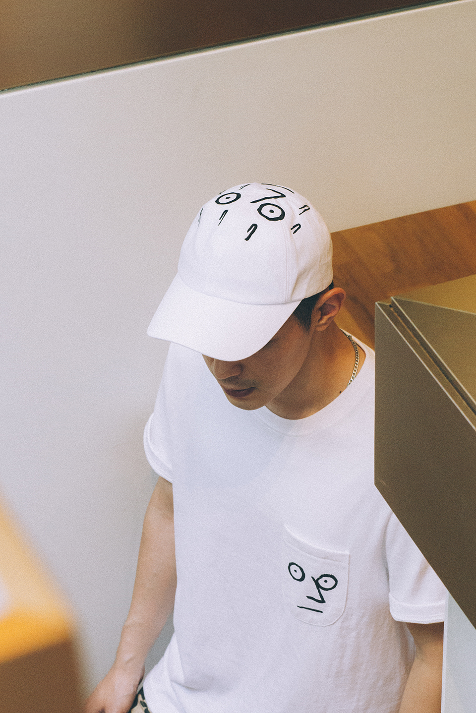 A cap and t-shirt from NouNou's new line