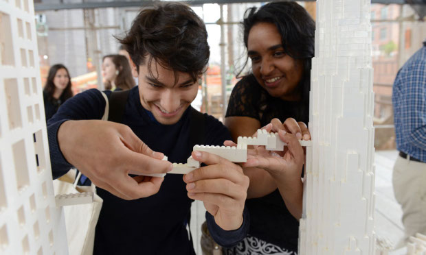 Visitors to the High Line's Collectivity Project add their own designs onto BIG's Lego skyscraper
