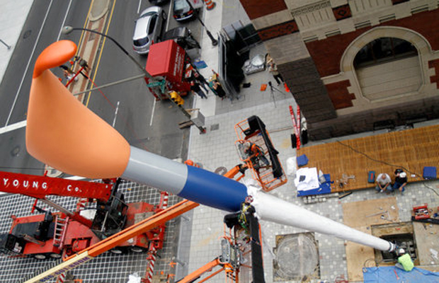 The installation of Claes Oldenburg's 'Paint Torch' outside the Pennsylvania Academy of the Arts in Philadelphia