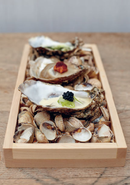 Poached rock oysters with pickled cucumber, beurre blanc and avruga caviar, as featured in The Sportsman